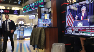 Traders work on the floor of the New York Stock Exchange (NYSE) as the Federal Reserve Board Chairman Jerome Powell holds a news conference on December 19, 2018 in New York City.