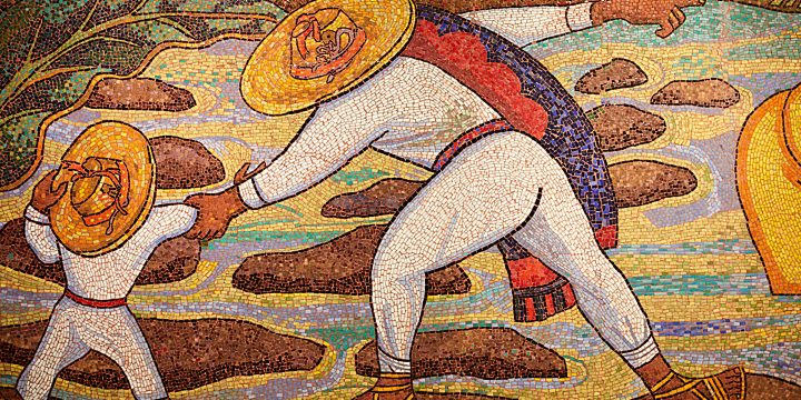 """River Bath"" by Diego Rivera. Mosaic mural in the Soumaya Museum in Mexico City, Mexico. The mural depicts a man and a boy, both clothed in white, standing on rocks in a river."