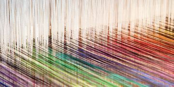 Colorful threads on an old-fashioned loom