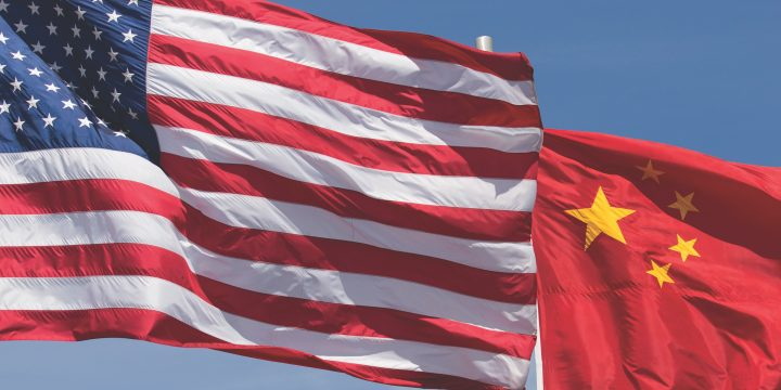Photograph of the United States and Chinese flags.