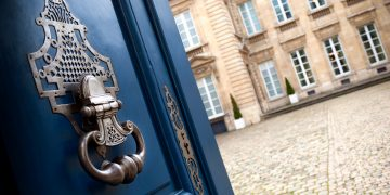 Door open to an old French mansion in Bordeaux