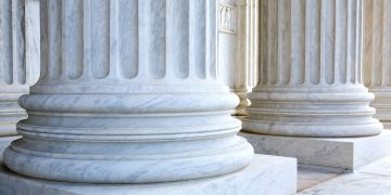 Architectural detail of columns located outside the United States Supreme Court building in Washington D.C.
