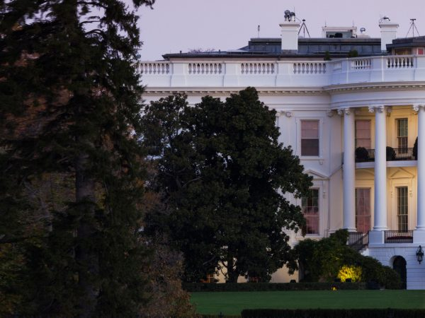 Close-up shot of the white house at dusk.