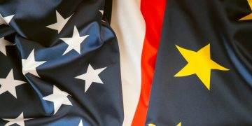 A close-up view of the flags of the United States of America and the European Union.