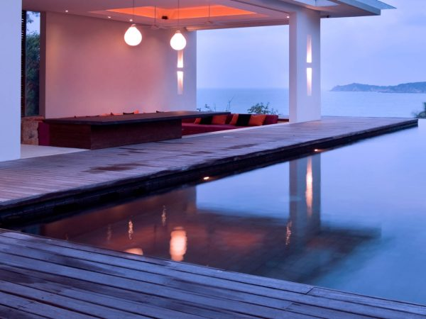 Serene modern home with an infinity pool overlooking the sea.