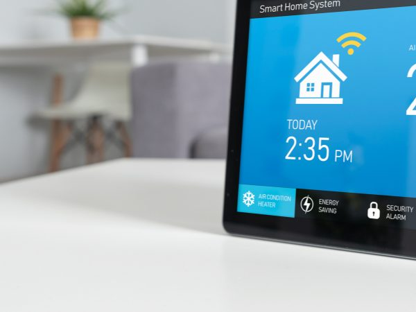 A smart home system device on a table in a modern living room