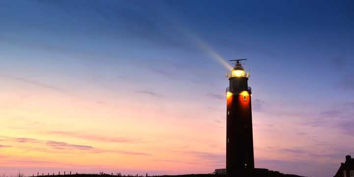 Photograph of a lighthouse at dusk.